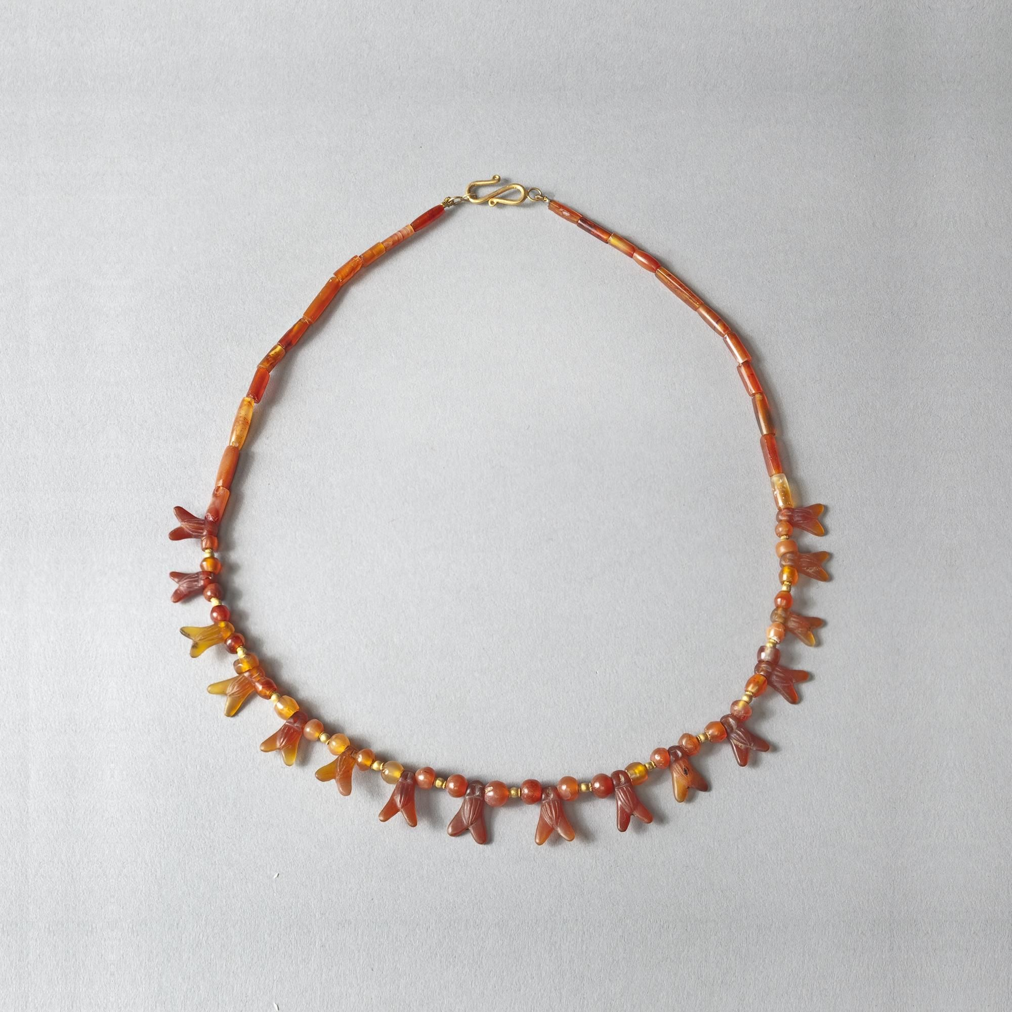 Carnelian Fly Necklace, Egypt, 18th Dynasty, 1549-1292 B.C., Carnelian, 47 cm © David Aaron