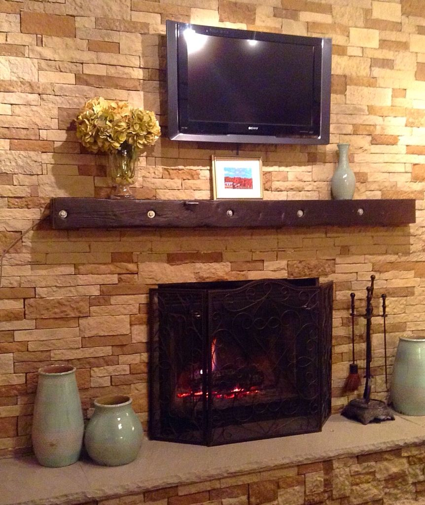 Tile Hearth: Our AirStone Fireplace Makeover. We Love It. Covered