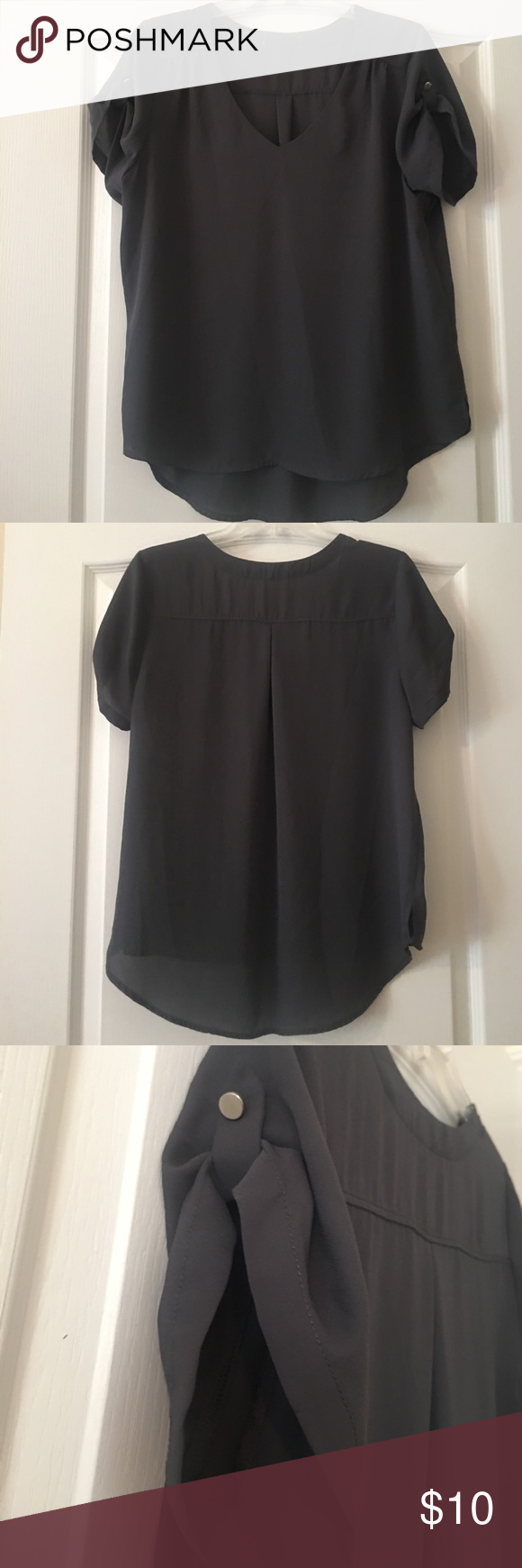 Grey blouse Flowy and flattering short sleeve grey shirt. Excellent condition. Has lovely embellishment on sleeves. Tops Blouses