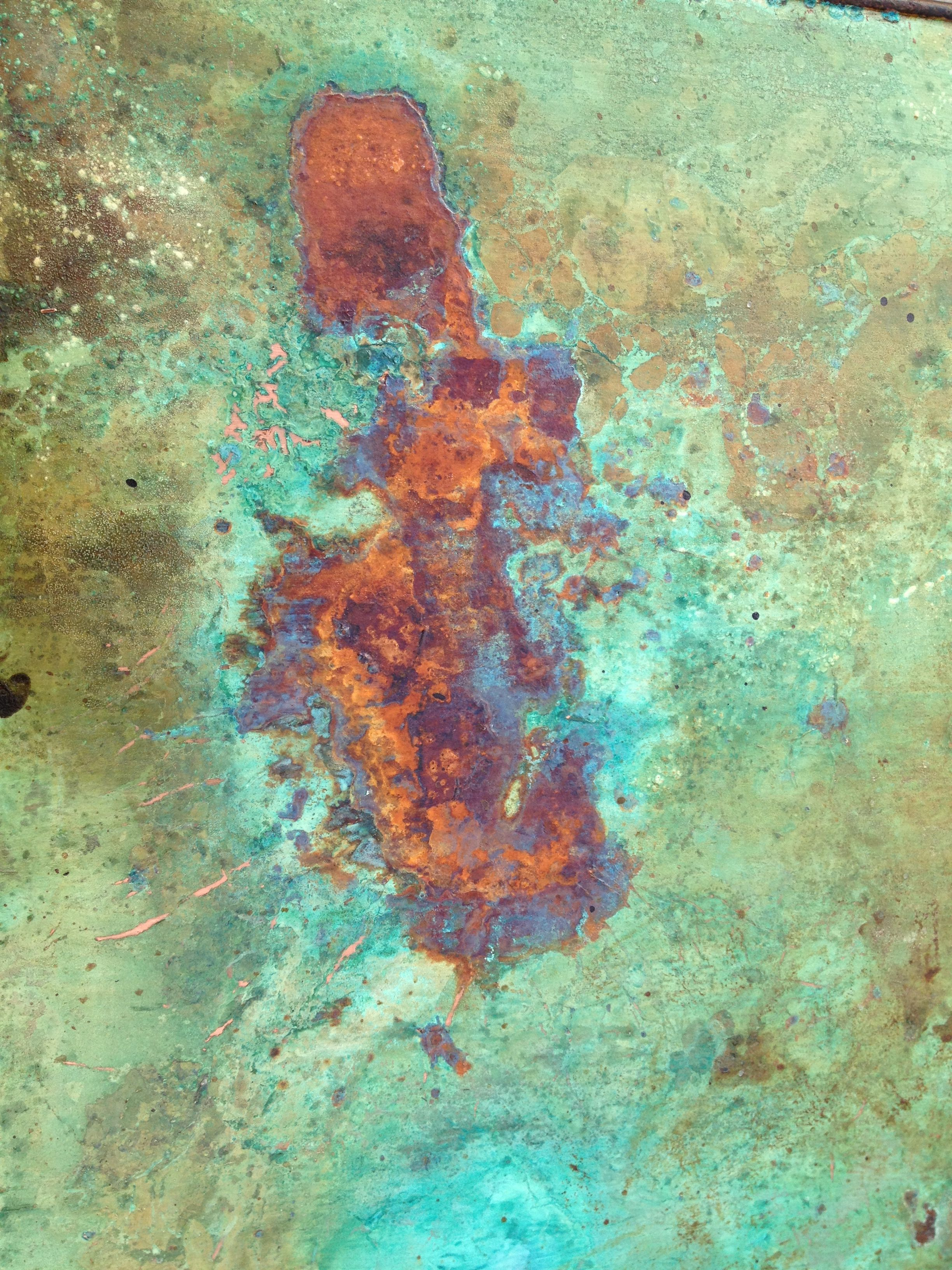 Close Up Of Copper Rust Patina Created On A Table Top By