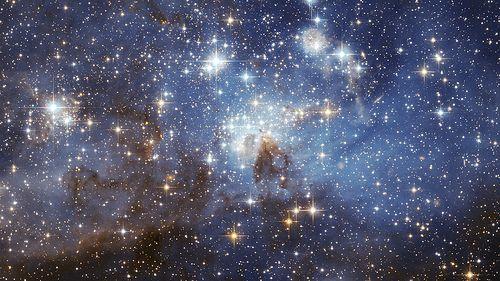 HubbleSite - Picture Album - LH 95 in the Large Magellanic Cloud