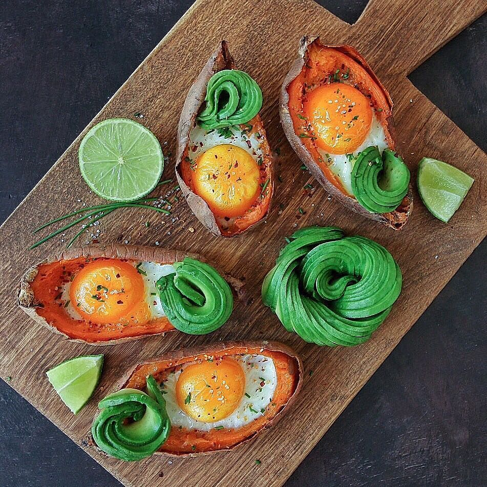 Baked eggs on potato skins with avocado chives sea salt & chili flakes. Have a wonderful Saturday! by cravingsinamsterdam