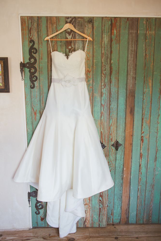 Wedding Dress Hanging Up Inside Of Venue Le San Michele