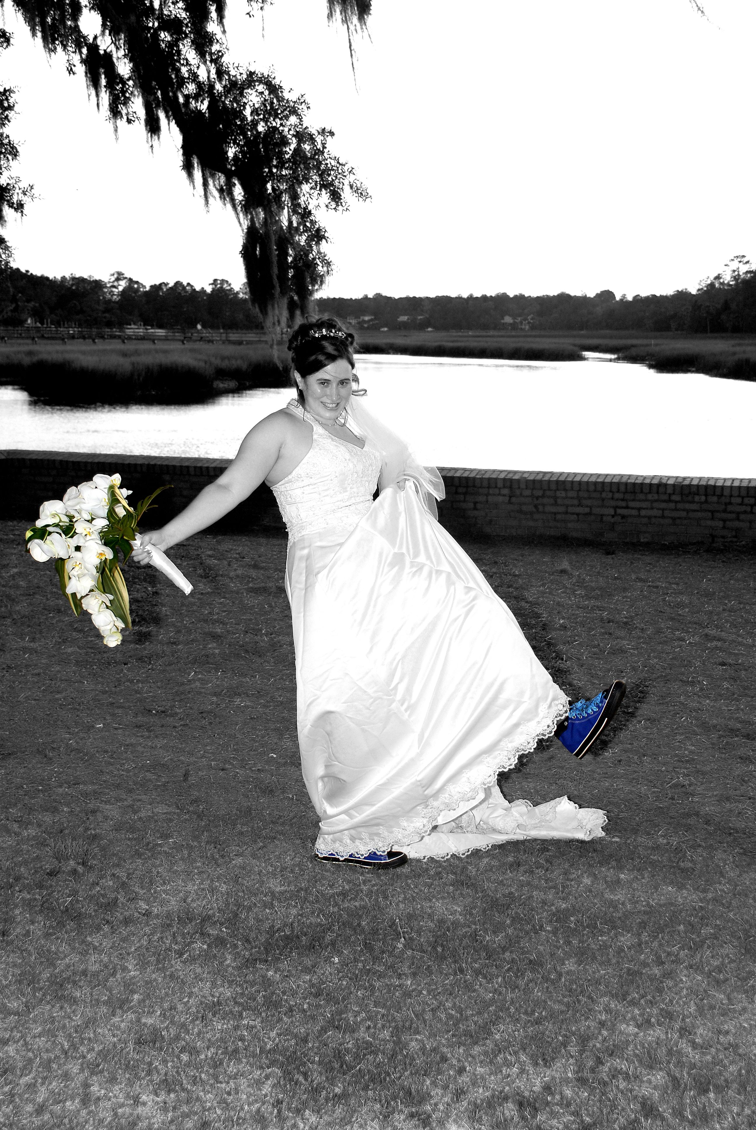 Wedding dress with black shoes  This bride had some fun with her converse wedding shoes  Wedding