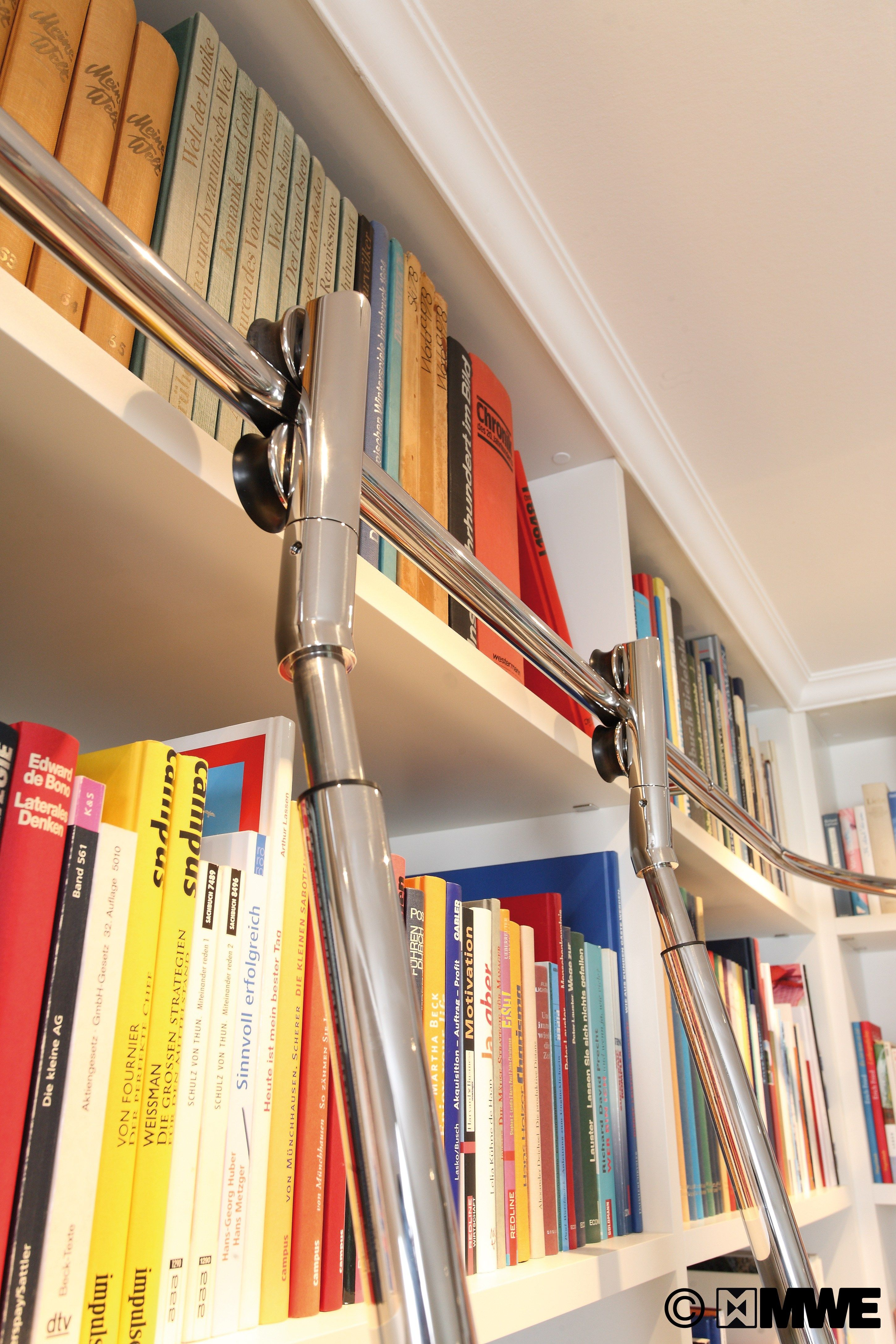 Special constructed vario telescopic library ladder with autostop