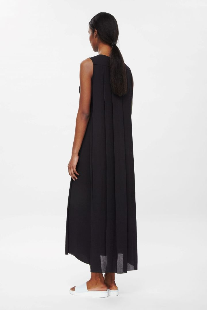 13c8d0aa6bf Tie-waist black pleated maxi-dress by COS. I love it! It s exquisite ...