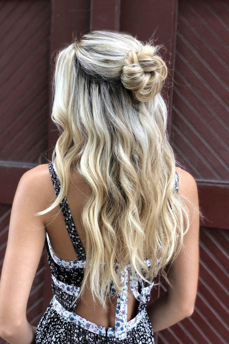 : half up hairstyle with loose waves + messy bun ...
