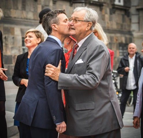 Crown Prince Frederik greets his father Prince Consort Henrik during the opening of the Danish parliament at Christiansborg Castle, October 6, 2015