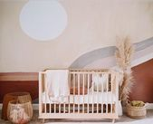 Get a peek inside the feminine yet boho nursery from Anewalls owner Sydney Penner for her sweet baby girl The whole room was designed around th