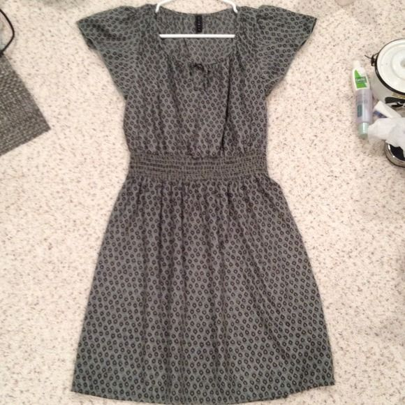 Olive/Purple dress Bought at a local boutique; worn one time. Olive dress with small purple flowers. Satiny material, with thick elastic waistband. Hits above knee. Dresses