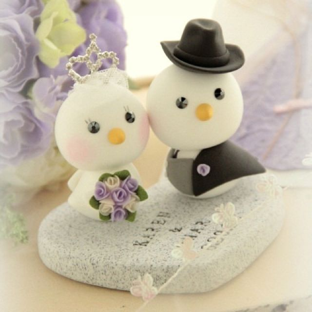 My wedding cake topper, two love birds with the groom wearing a cowboy hat. Made by Kikuike from etsy.