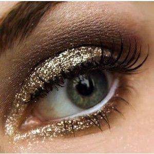 Golden sparkle make up, glitzy eyes.