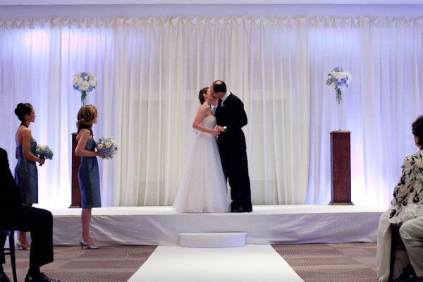 Rent A Fabric Backdrop For An Indoor Wedding Ceremony And