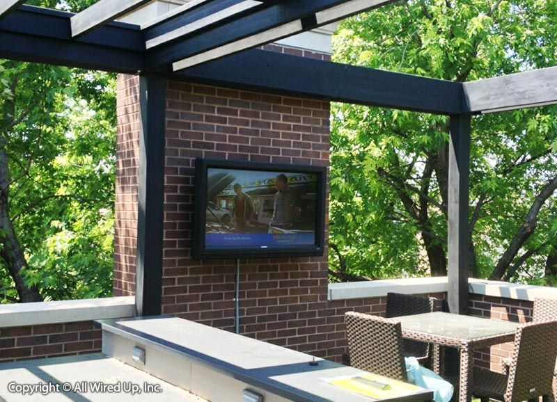 Great looking outdoor patio wit wall mounted flat panel tv