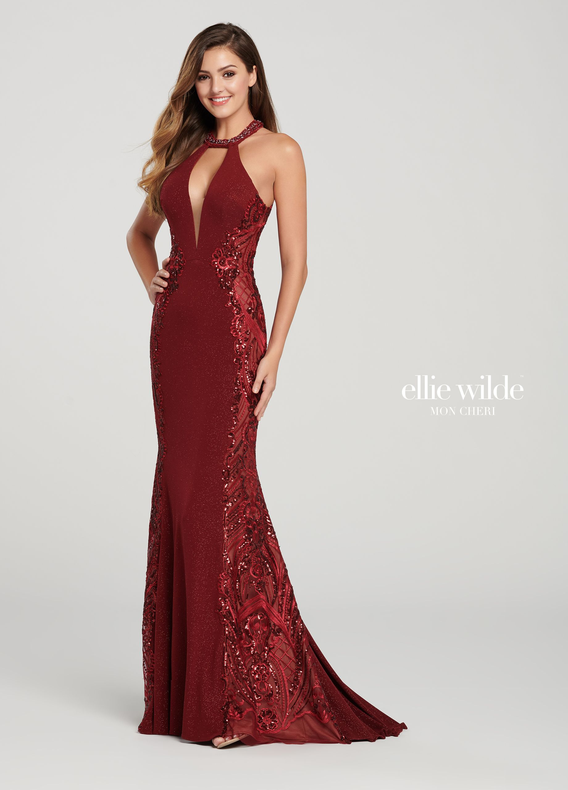 b56c5908373 Ellie Wilde EW119110 - Turn heads in this sleeveless glitter jersey fit and  flare gown with a beaded halter collar, a deep plunging sheer front  keyhole, ...