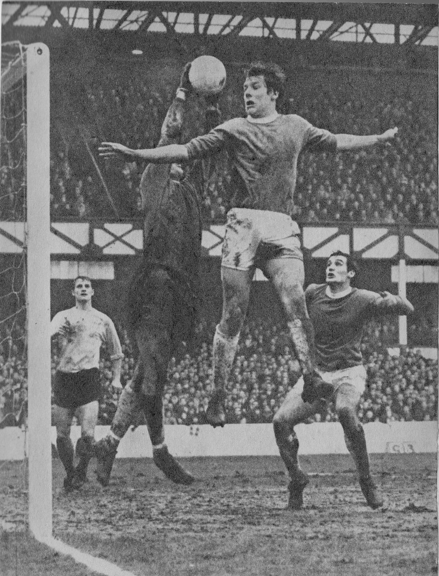 18th January 1969. Ipswich Town goalkeeper David Best snatches the ball off the head of Everton centre forward Joe Royle, at Goodison Park.
