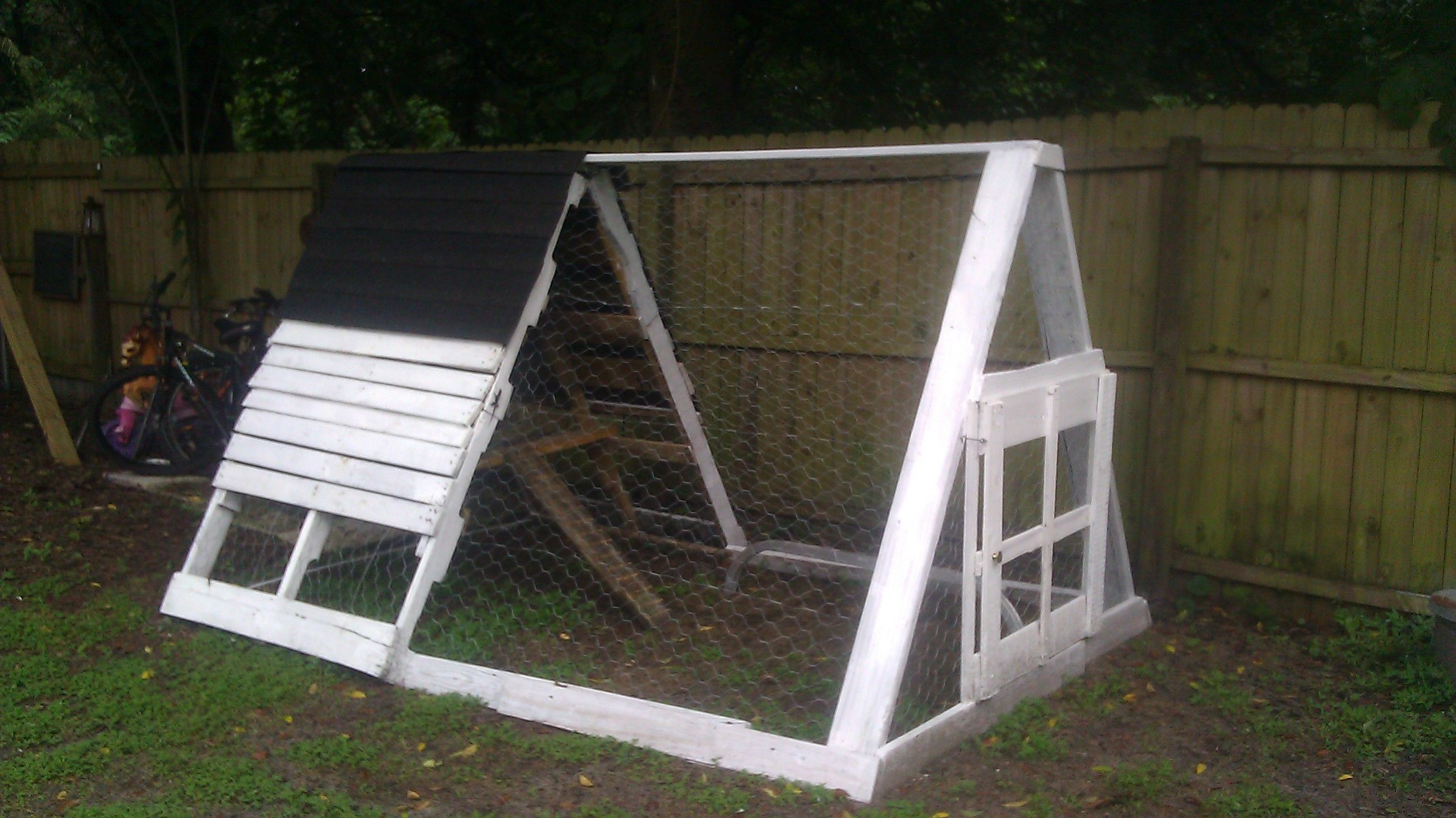made my own chicken coop for $20!!...used 2 long pallets and scrap ...