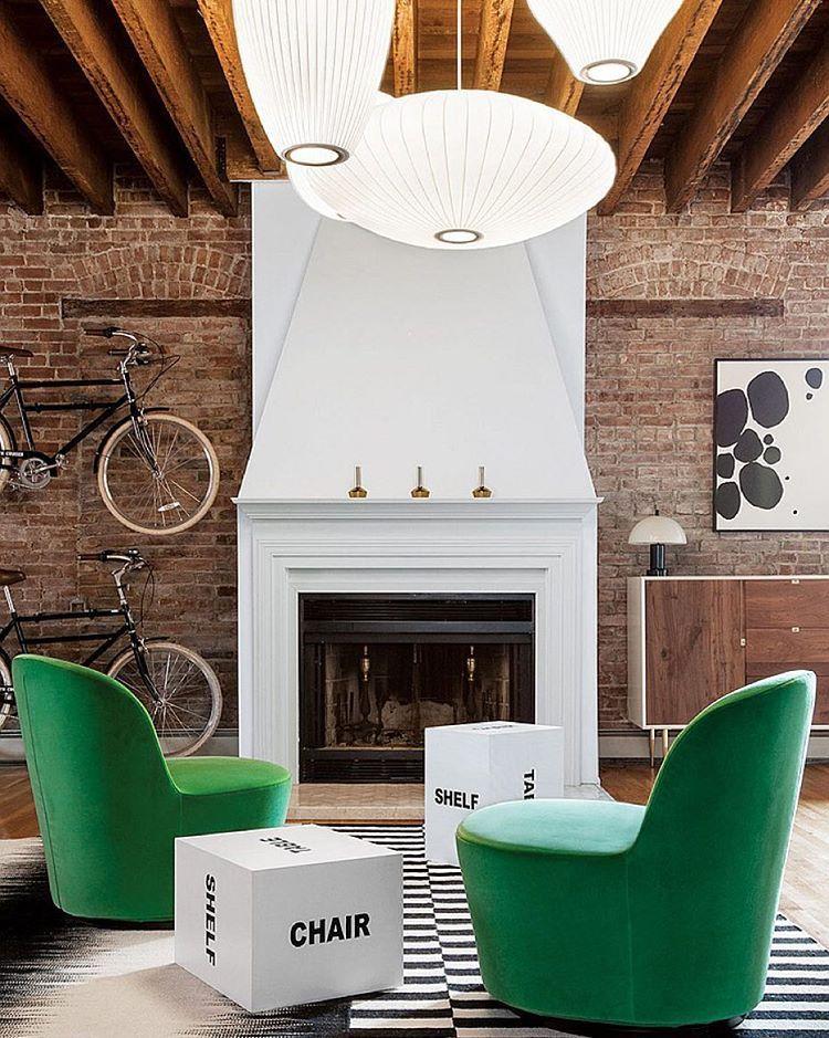 Beyond the warm living area in this Jersey City loft by New Design Project, one seemingly abstract canvas is actually Morse code telling the history of the 1899 building, a stable turned warehouse for the Metropolitan Opera. Photography by @algastelum. @thenewdesignproject #interiordesign #interiors #jerseycity #loft #warehouse #architecture