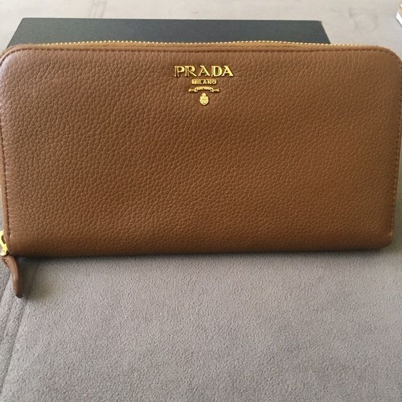 9bbceaf22904ba PRADA Wallet Like New! PRADA Vitello Grain leather wallet in Cannella  color. Beautiful and