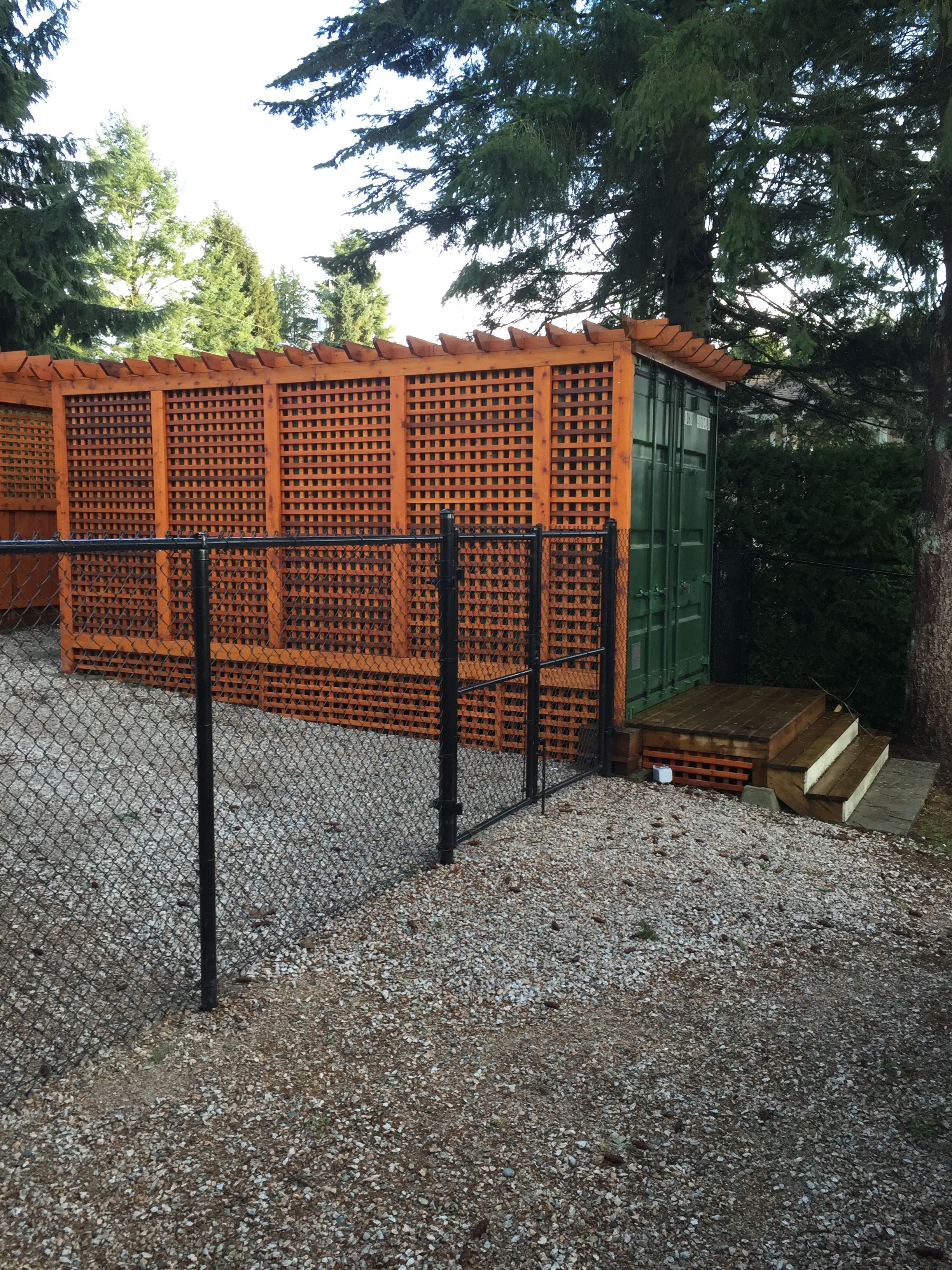 Shipping Container Camouflaged With Cedar Lattice . Hidden Storage .