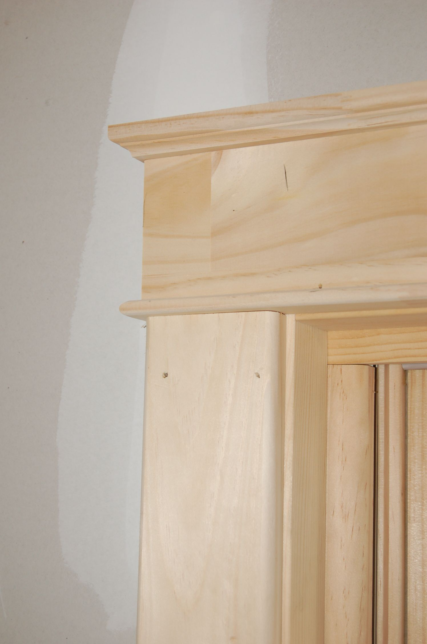 Doorway molding gallery of how to install a bifold closet for Over door decorative molding