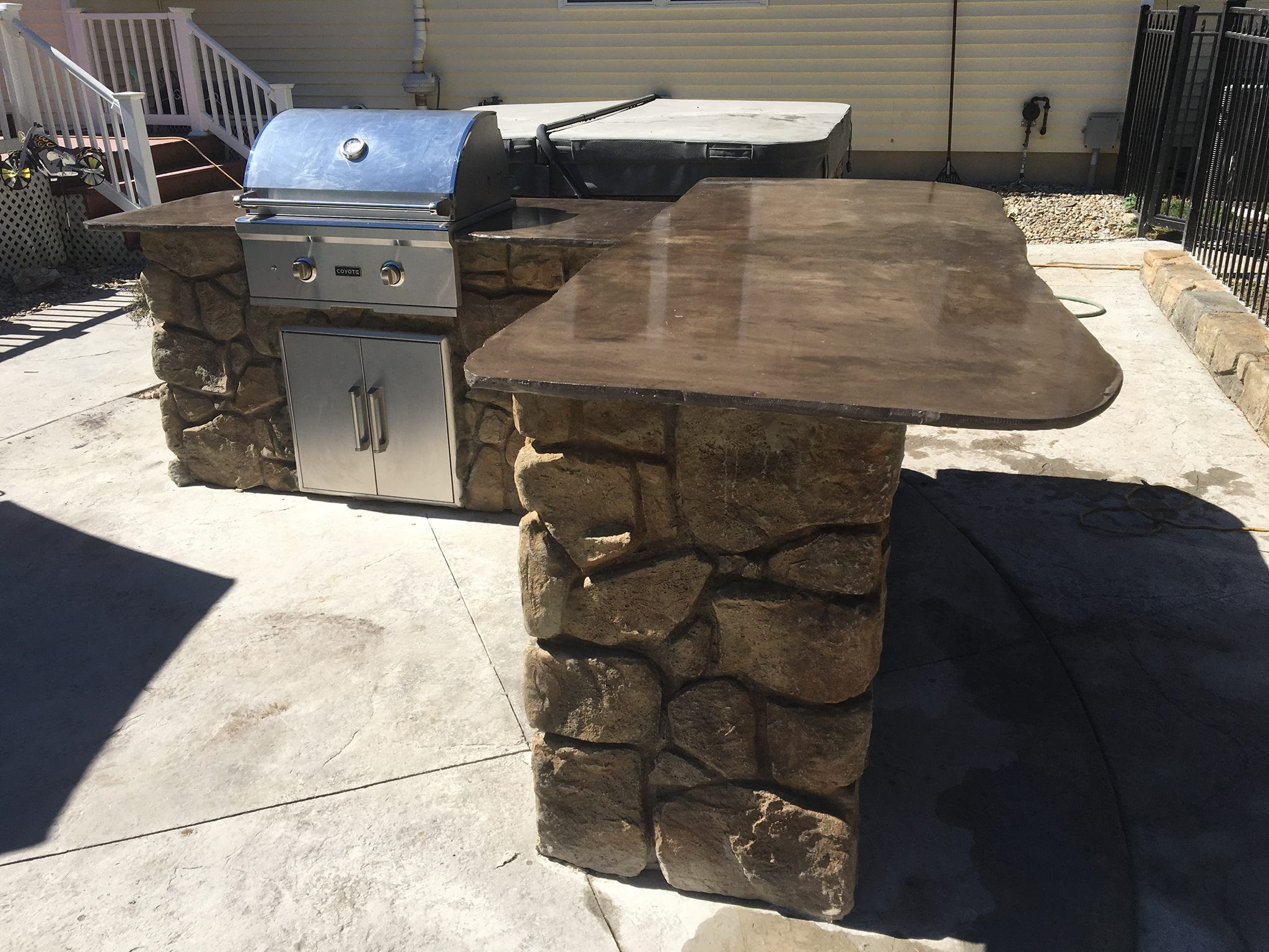 Custom stone style outdoor kitchen with grill in pittsford ny