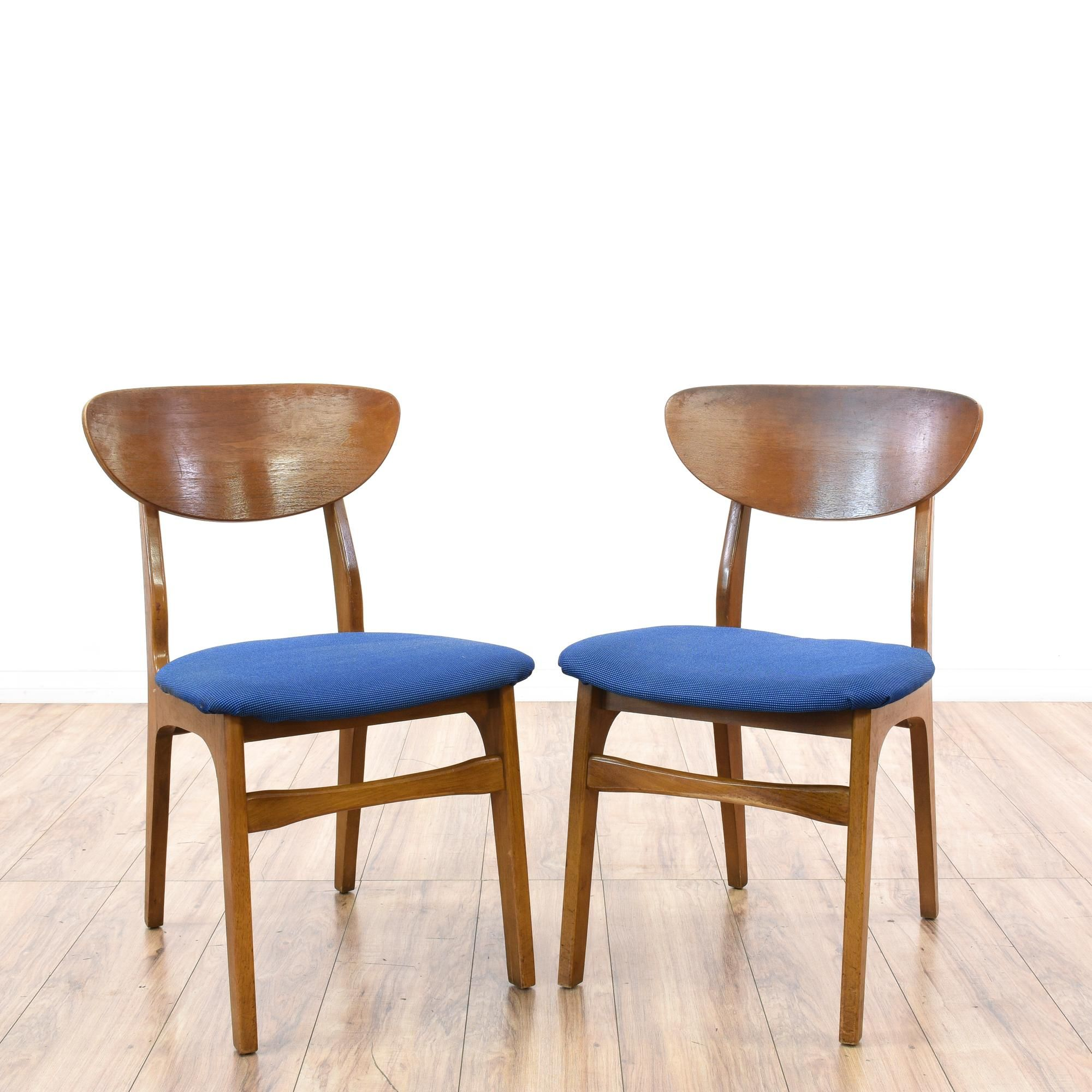 This pair of accent chairs are featured in a solid wood with a