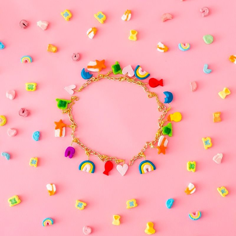 Save this style DIY tutorial to learn how to make a Lucky Charms charm bracelet as the most magical St. Patrick's Day accessory.