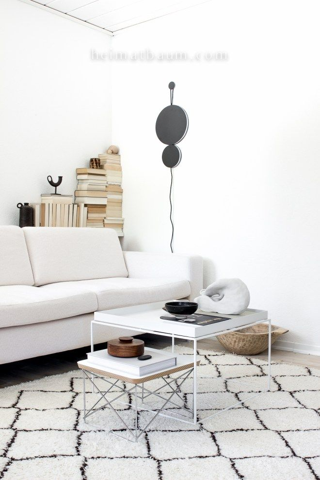 Beautiful Black And White Living Room: A White Couch, Two White Coffee  Tables And