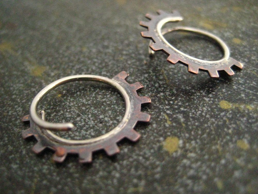 Small gear blade hoop earrings.   $40.00, via Etsy.