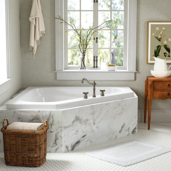 Ready to turn your master bathroom into a calming retreat, this corner soaking tub is everything you need in your master bathroom. Made by expert craftsmen from extra-thick acrylic that's bound to stand the test of time, this tub measures 59.25'' L x 59.25'' W x 21.25'', has an 85-gallon capacity, and comes with an overflow drain. We love its glossy white finish and timeless unique shape complement just about any bathroom aesthetic from Americana to traditional farmhouse. Something to keep in mi