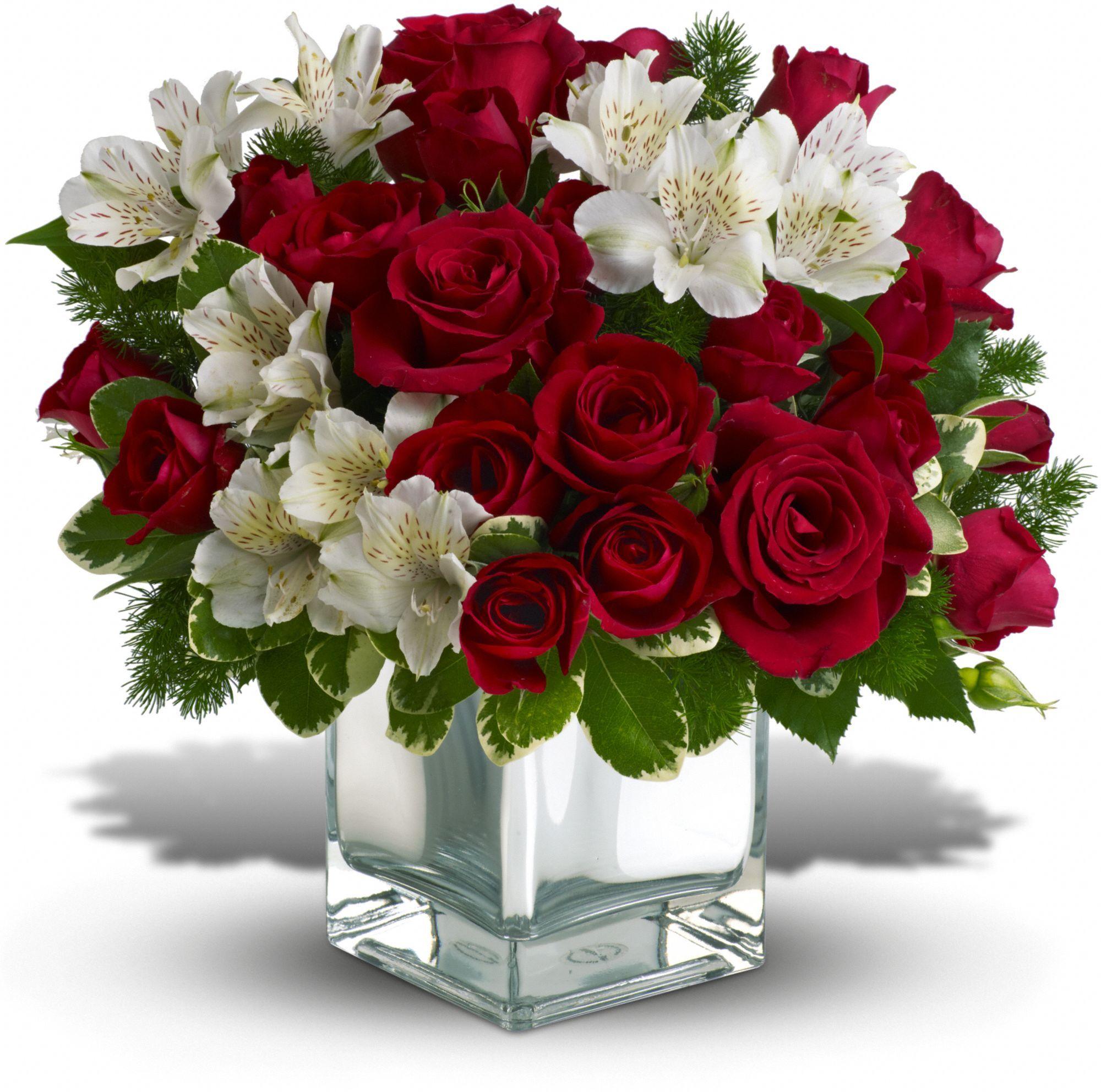 O Elegante Arranjo De Flor De Natal Inclui Rosas Vermelhas