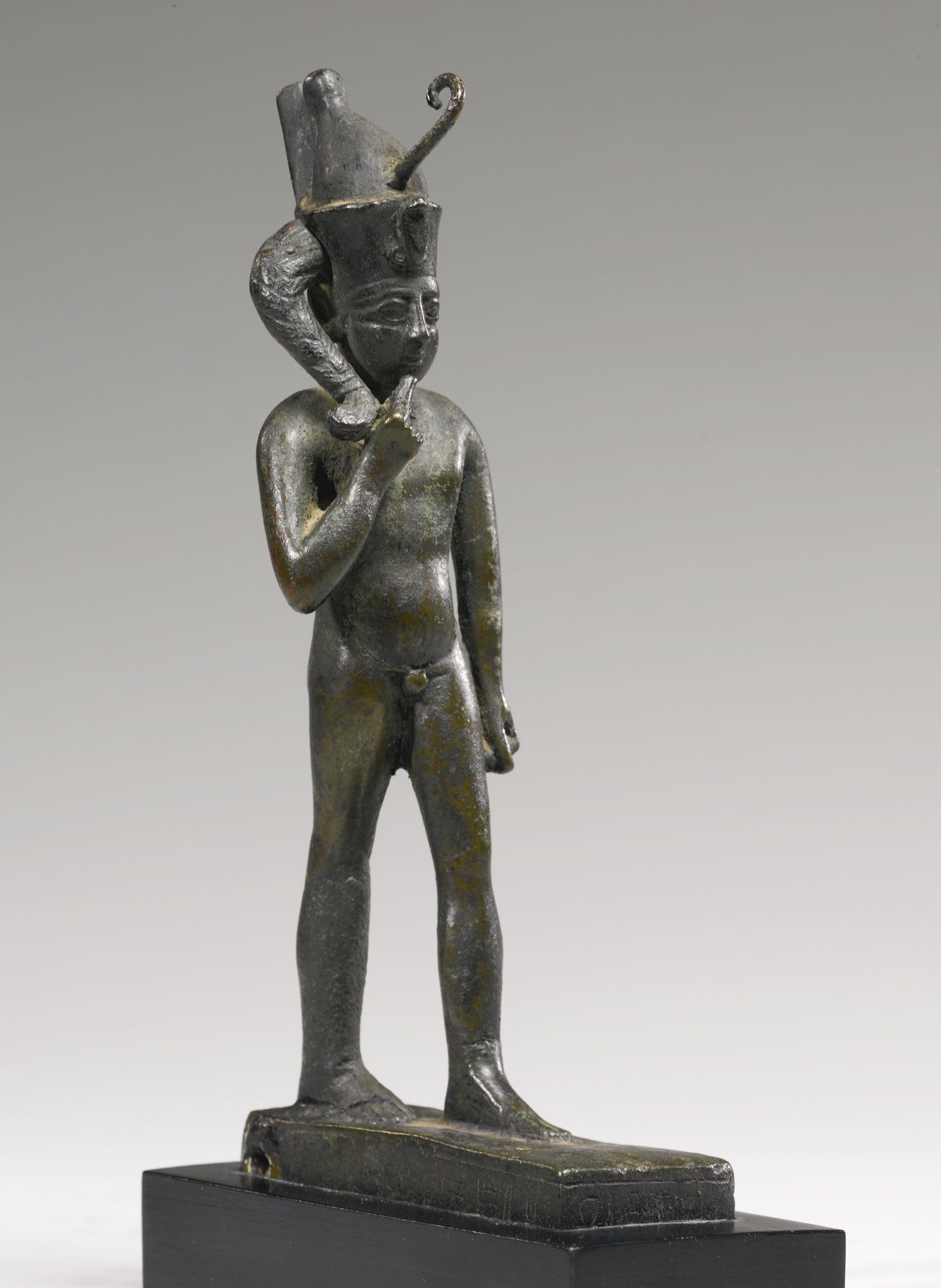 An Egyptian Bronze Figure of Harpocrates, Late Period, 716
