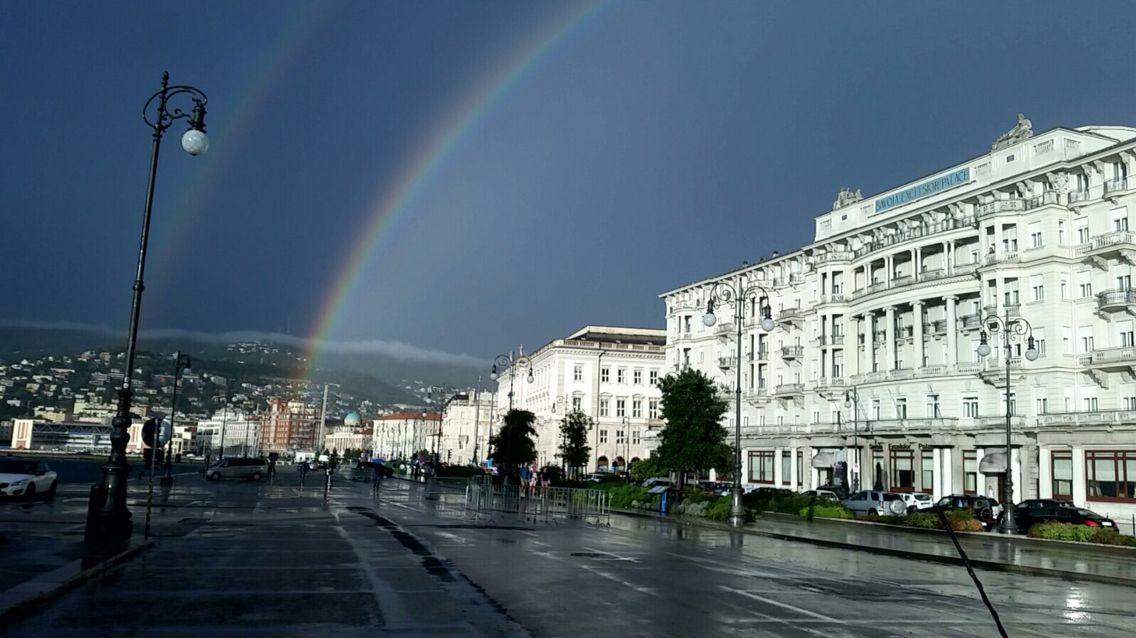 View of a rainbow near Piazza Unità