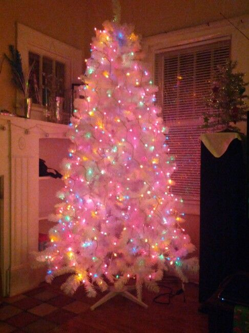 Our White Christmas Tree With Colored Lights Before The Ornaments