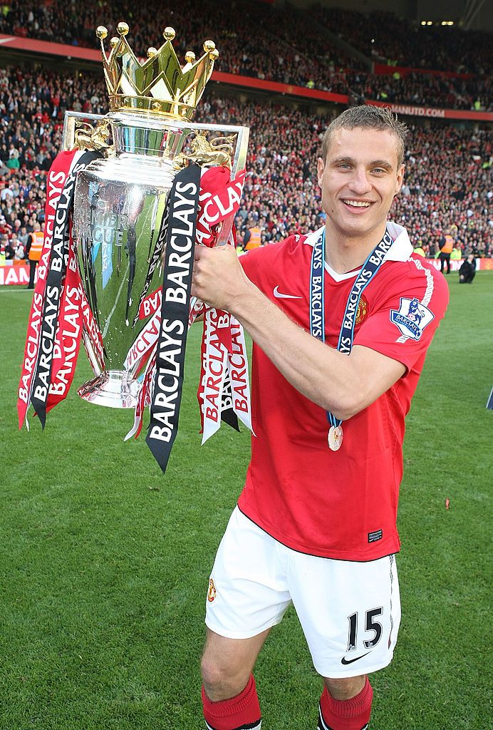 Get Good Looking Manchester United Wallpapers Old Trafford MANCHESTER, ENGLAND - MAY 22:  Nemanja Vidic of Manchester United celebrates with the Barclays Premier League trophy after the Barclays Premier League match between Manchester United and Blackpool at Old Trafford on May 22, 2011 in Manchester, England.  (Photo by Matthew Peters/Man Utd via Getty Images)