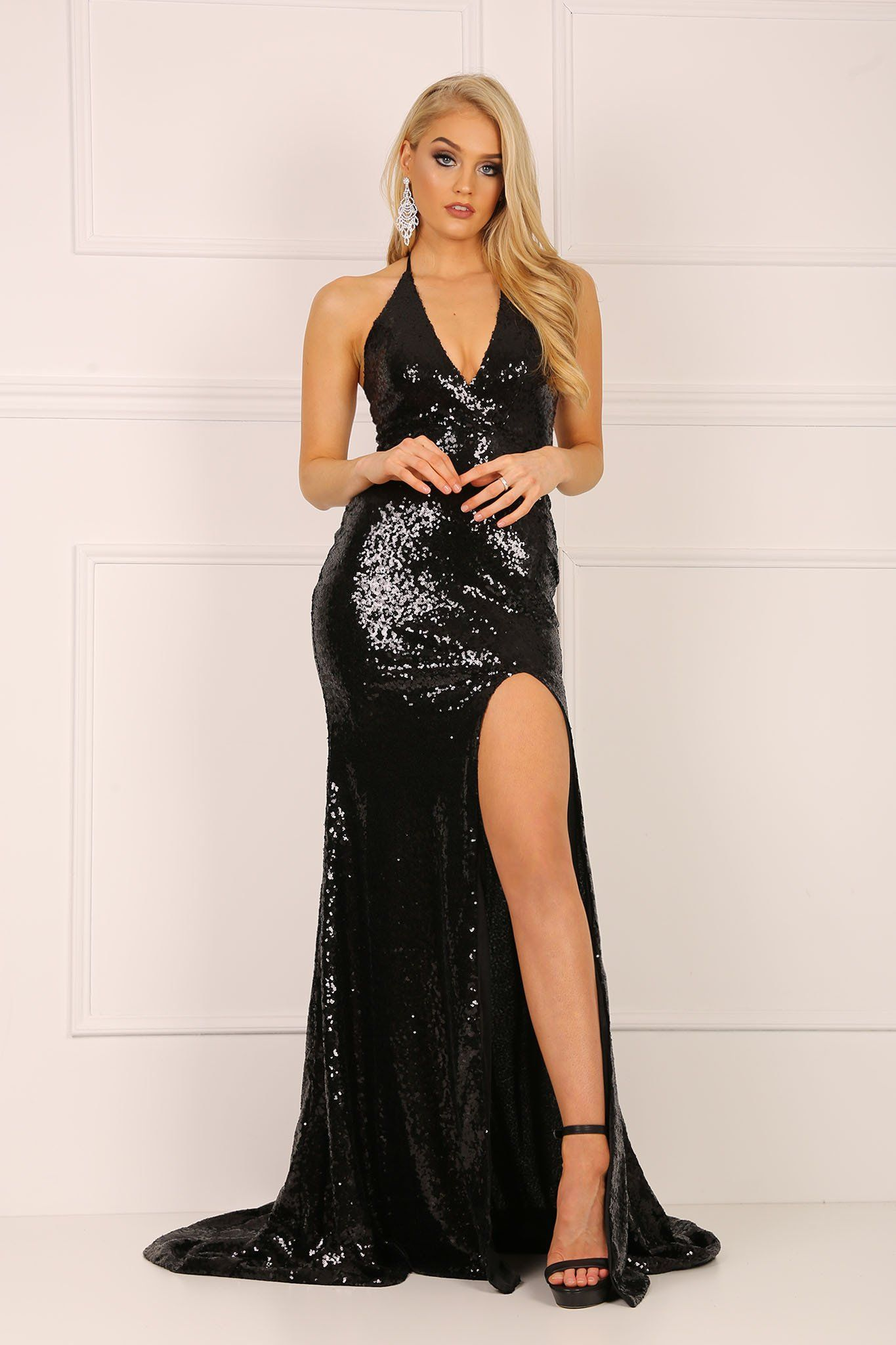 1a907f9cb2197 Black sleeveless sequin mermaid gown with deep V neckline