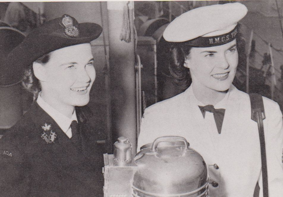 "Two typical members of the Canadian Womens Royal Naval Service (""Wrens"") in WWII. A signals officer (left) and an Ordinary Sailor (right)."