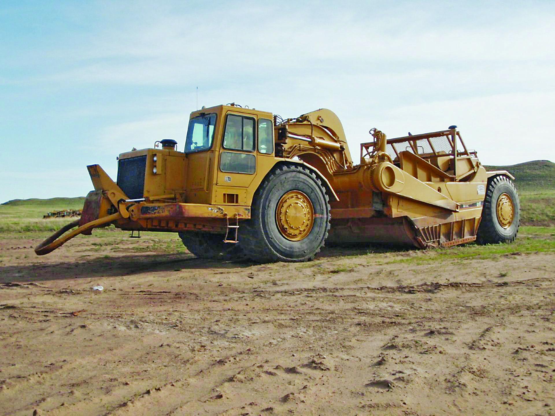 Caterpillar 657E motor scraper | Yellow Iron | Heavy