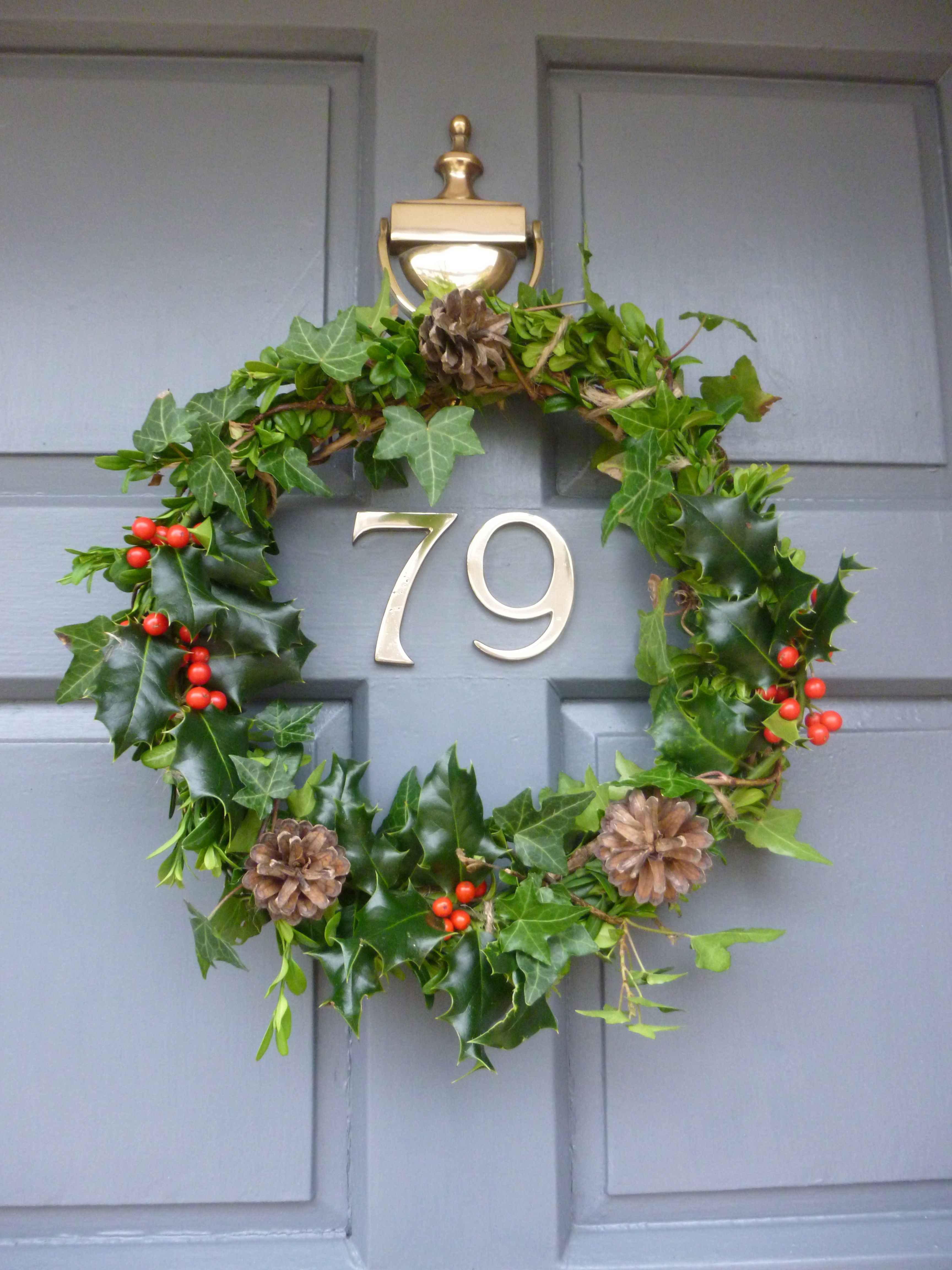Home made wreath foraged from the garden holly ivy and sprigs of