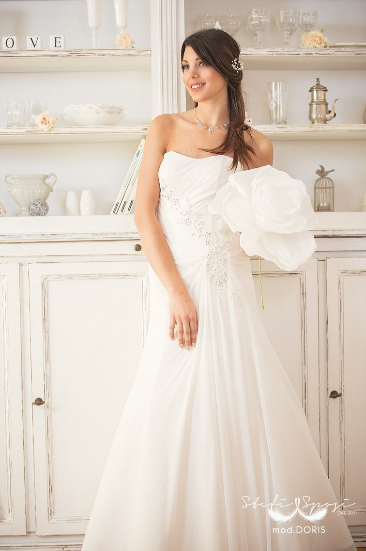 White bride.. Soft dress by Stefi Sposi.. Made in Italy.. Paper flower & decorations : Danielle Design