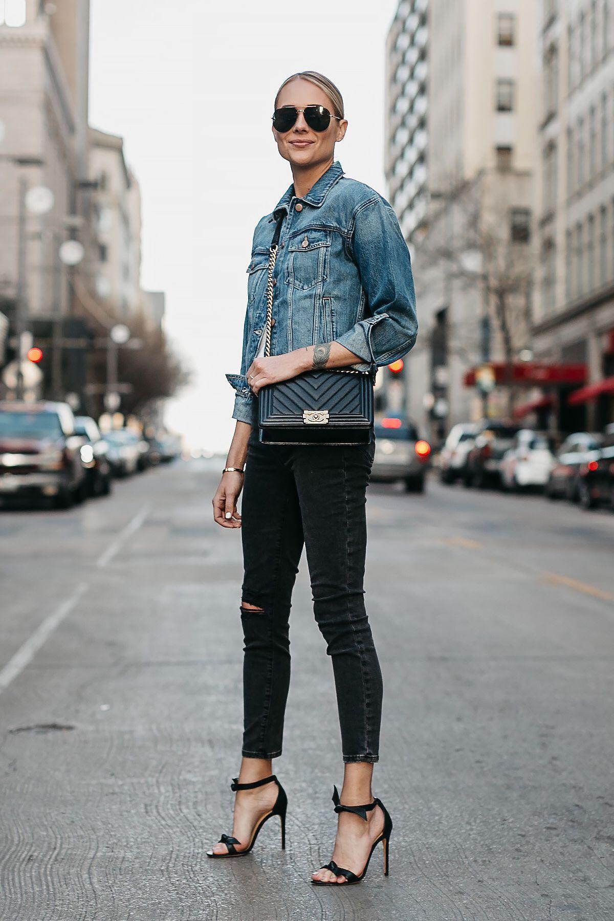 c03fc1fb706 Blonde Woman Wearing Joes Jeans Black Ripped Skinny Jeans Denim Jacket  Chanel Black Boy Bag Alexandre Birman Black Bow Heels Celine Aviator  Sunglasses ...