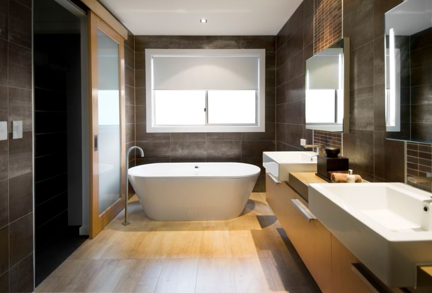 australian luxury bathroom with brown tiles and hardwood floor focusing on a free standing bath clipping path around the windows and reflections in - Bathroom Remodel Modern