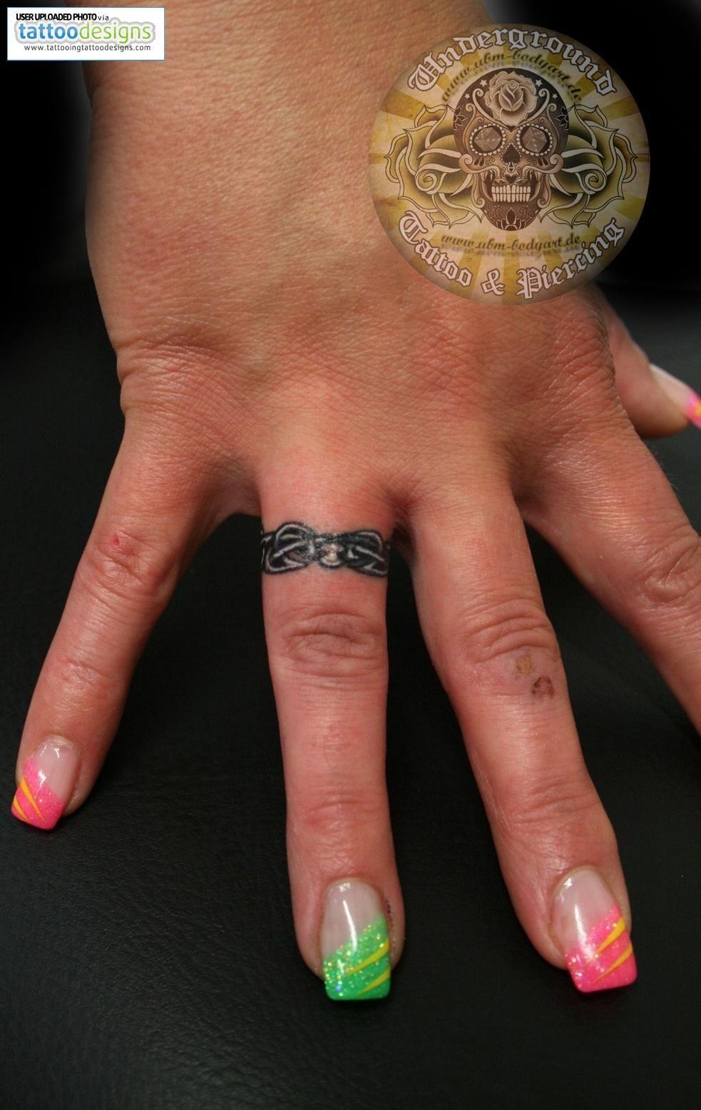 Grey Ink Celtic Ring Tattoo On Finger Ring finger