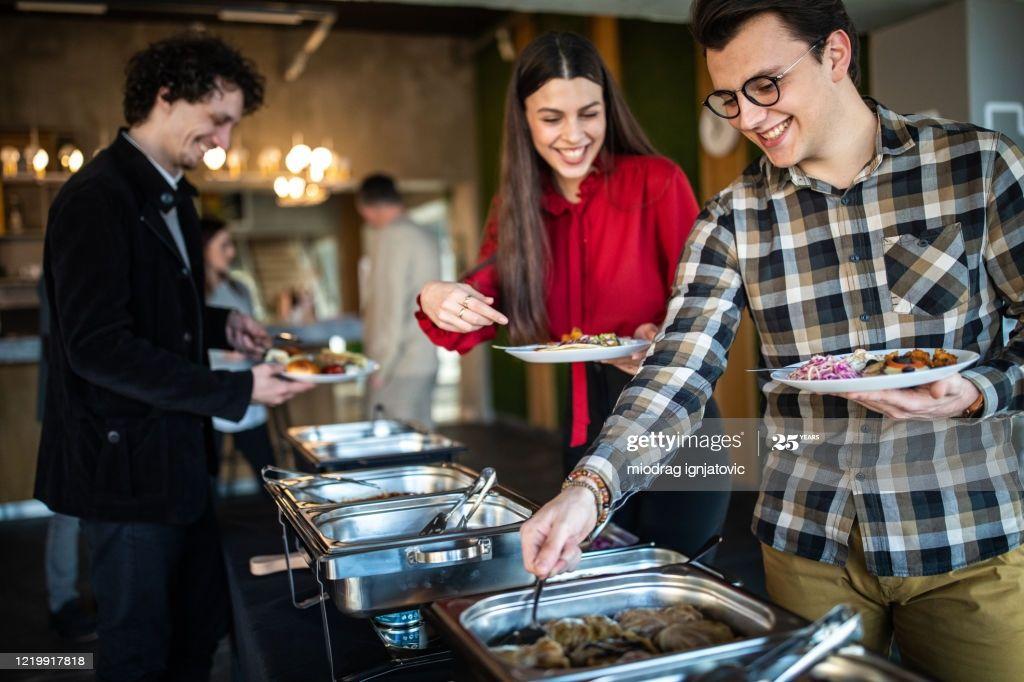 Colleagues choosing food during lunch break at self