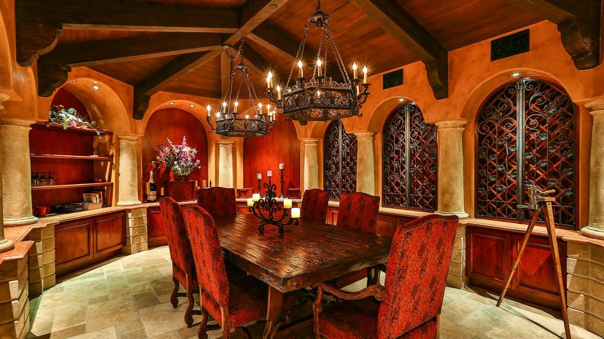 This more formal area features dramatic light fixtures and dark wood decor.