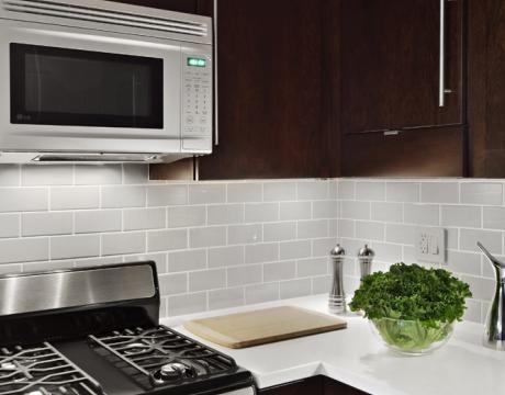 Grey Tile Backsplash White Countertops Cherry Cabinets Tiny Kitchen Kitchen Makeover Kitchen