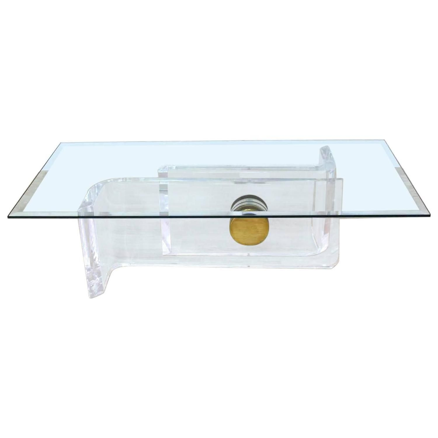 large rectangular glass top thick lucite and brass base coffee
