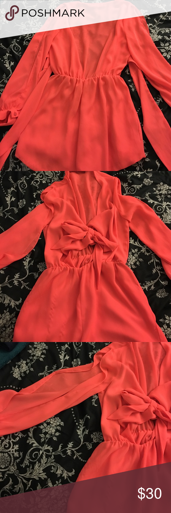 Akira romper V neck with tie chiffon neon coral This neon coral romper from AKIRA Chicago has only been worn twice and is super cute! It ties up in the front and is chiffon material. AKIRA Pants Jumpsuits & Rompers