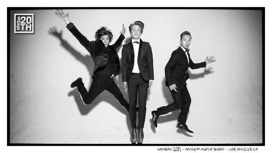 "Photo 324 of 365 HANSON 2013 - ANTHEM Photo Shoot - Los Angeles CA	  In this pic Isaac, Taylor and Zac are caught mid jump, having a good time during the ANTHEM album photoshoot. Give us a one word name for each guys pose, eg - Isaac is doing ""The ____"" etc.  #Hanson #Hanson20th"